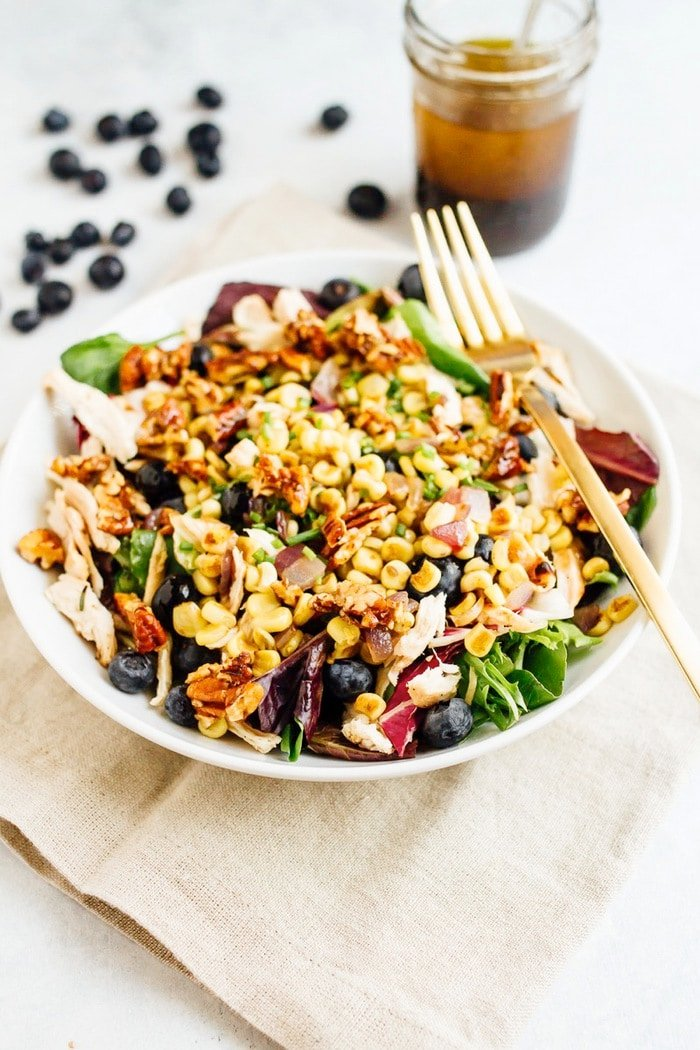 The perfect summertime blueberry corn chicken salad with fresh blueberries, grilled corn, shredded chicken, roasted pecans and a maple balsamic dressing.