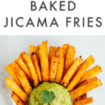"Jicama fries on a plate with a bowl of guacamole for dipping. Text on top reads ""Golden Gut Baked Jicama Fries"""