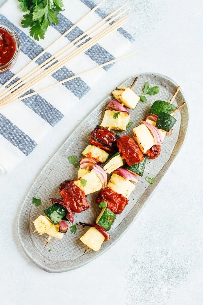 Bring on the BBQ tempeh skewers! You'll love this plant-based grilling recipe where nutty tempeh is coated in homemade BBQ sauce and grilled to perfection with zucchini, summer squash and red onion.