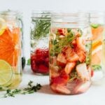 Fruit and herb infused water in mason jars.