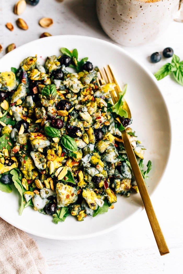 Blueberry Eggs Breakfast Salad with basil and pistachios on a plate.
