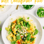 """Bowl of tuna curry with cauliflower rice topped with cilantro. Text above reads """"Tuna Curry Bowl with Cauliflower Rice"""""""