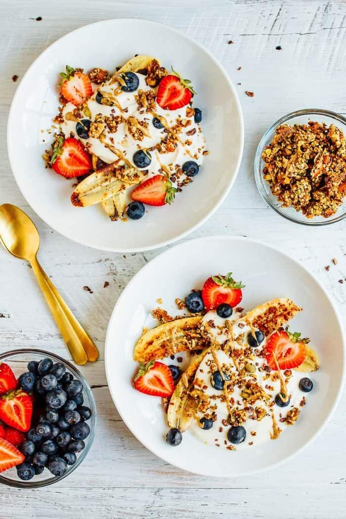 VEGAN Banana split Breakfast Bowl with Dairy-Free Yogurt, Caramelized Bananas, Berries and Grain-Free Granola