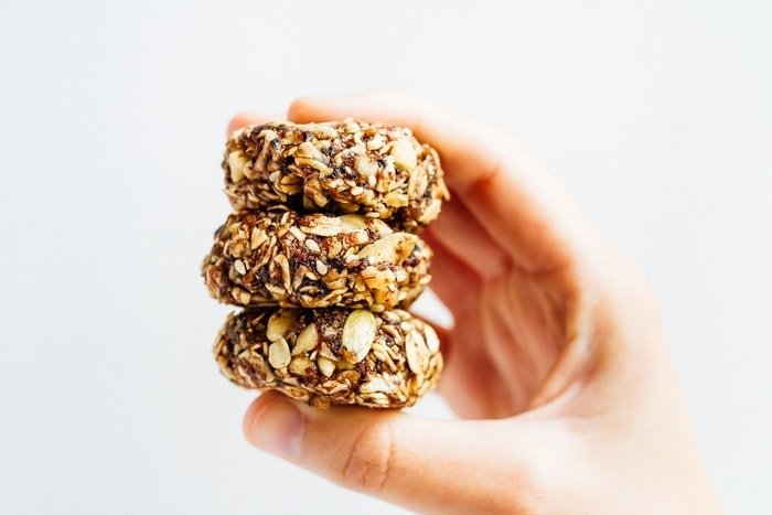 Eat like a bird with these BIRD FOOD ENERGY BITES! Made with whole grain oats, nuts, seeds and dried fruit, these bites are a nutrient-rich treat perfect for on-the-go snacking. Vegan + gluten-free.