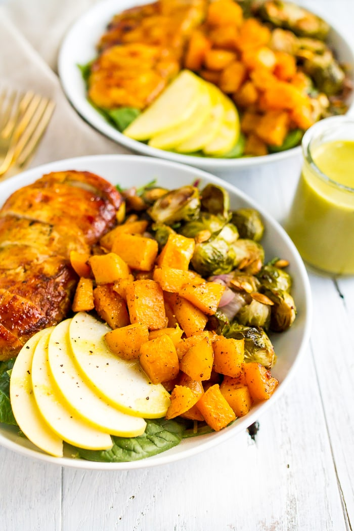 Roasted harvest bowls loaded with maple turmeric chicken, brussel sprouts, butternut squash, and apples.
