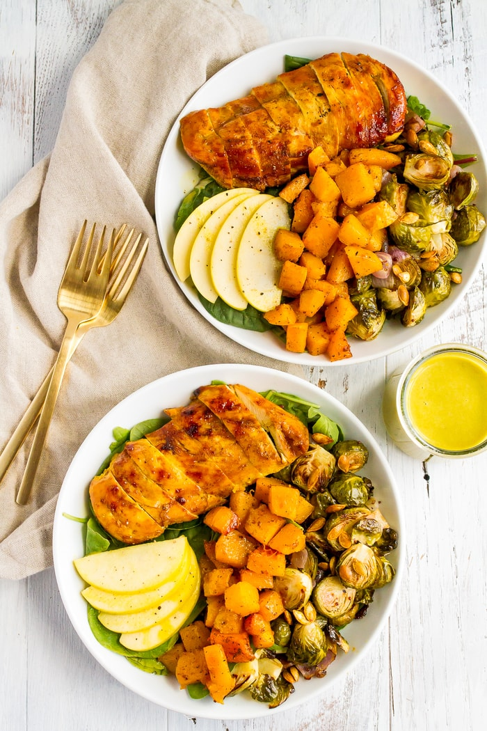 Roasted harvest bowls with veggies, apples, maple turmeric chicken, and an apple cider dressing.