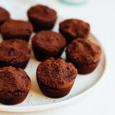 Brownie bites on a white plate.