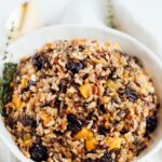 Bowl of wild rice stuffing with butternut squash and dried cherries.
