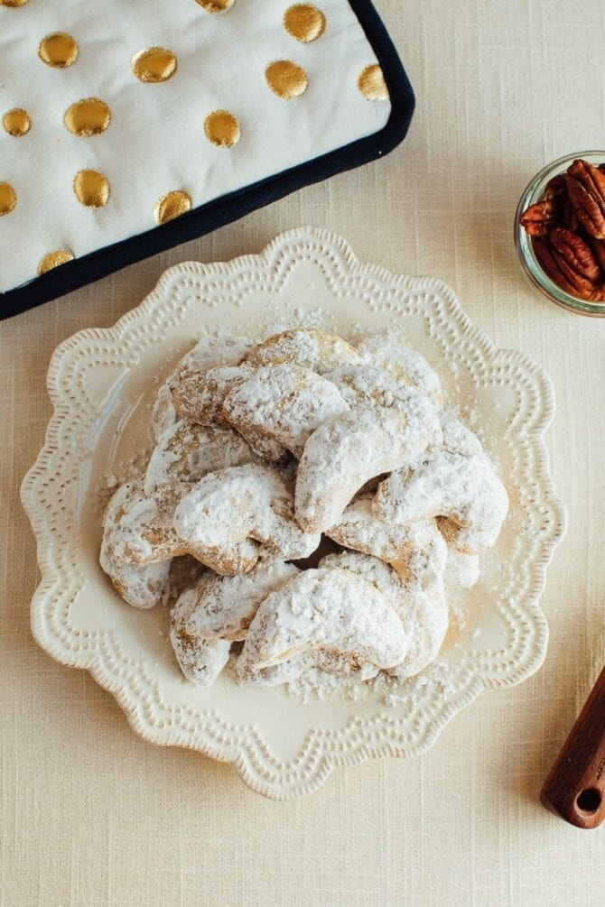 Plate with almond flour crescent cookies.