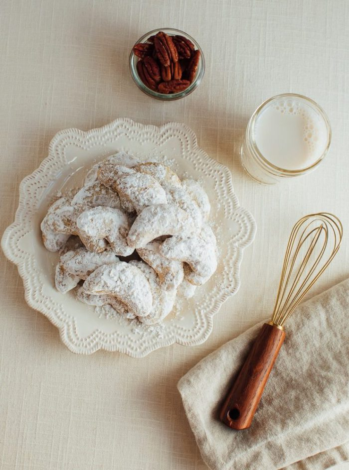 almond flour crescent cookies with powdered sugar on a plate