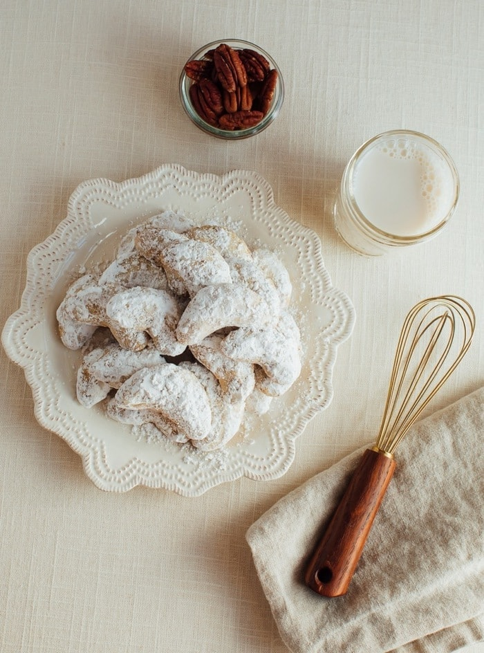 These simple almond flour crescent cookies are a healthy take on my nanny's signature crescent cookie recipe. Each cookie only has about 60 calories and 2 grams of sugar plus they're gluten-free and easily made vegan!