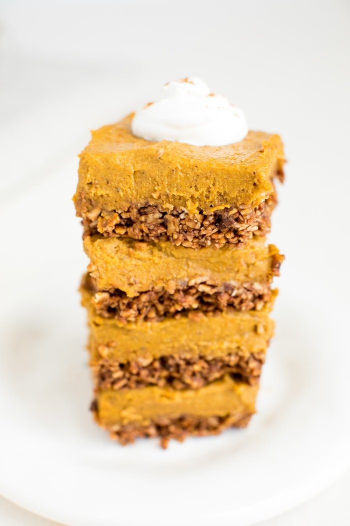 These decadent pumpkin pie bars pair a crunchy granola crust with a creamy, thick pumpkin filling with coconut oil and cashew butter. Vegan & gluten-free.