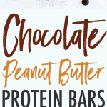 Chocolate Peanut Butter homemade protein RXBARs on a white table with chocolate chips.