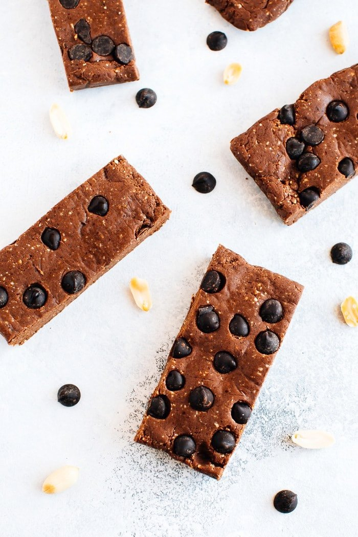 Protein bars with peanuts and chocolate chips sprinkled around