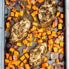 Sheet pan with baked butternut squash, onion, and za'atar chicken.