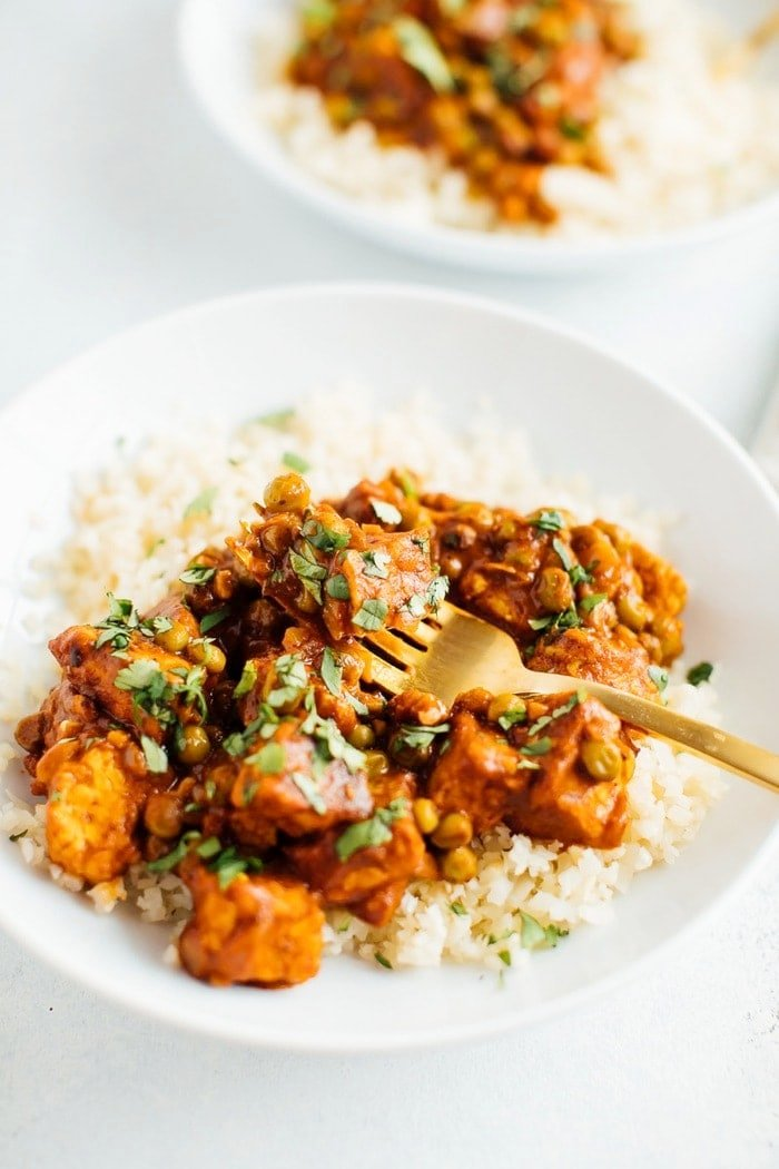 Vegan Tempeh Tikka Masala up close with a fork