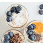 "Text ""How to make grain-free ""oats"""" Photo of three glass jars of grain-free oats topped with blueberries, cacao nibs coconut flakes, and peanut butter."