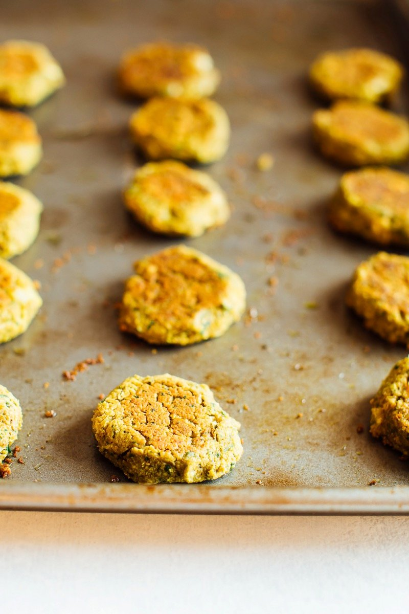 Falafel patties on a baking sheet