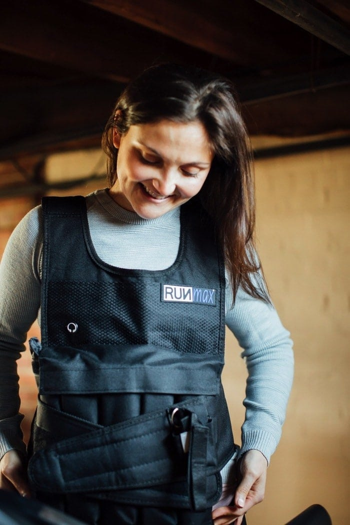 Woman wearing a weighted vest.