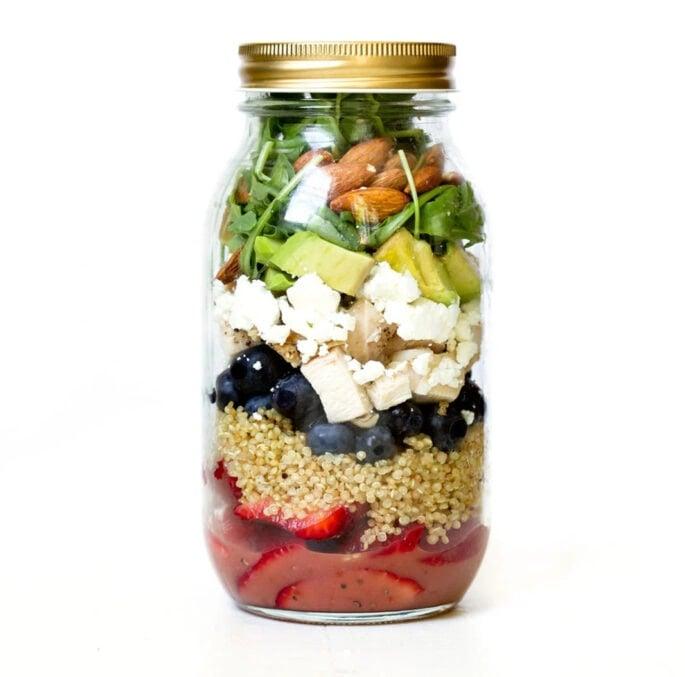 Balsamic chicken berry quinoa mason jar salad on a white background.