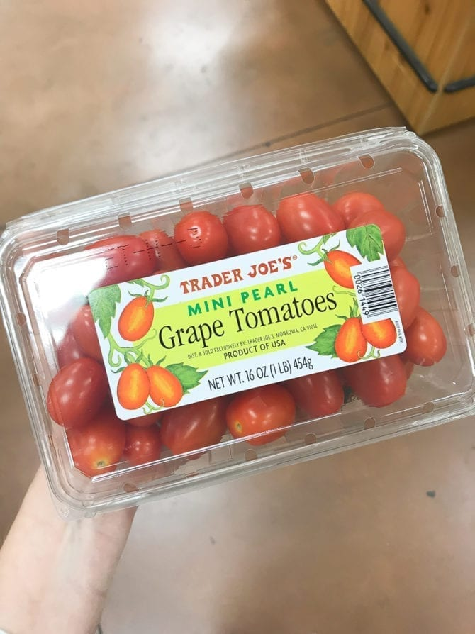 Container of Mini Pearl Grape Tomatoes.