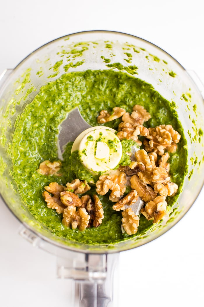 Walnut pesto being made in a food processor