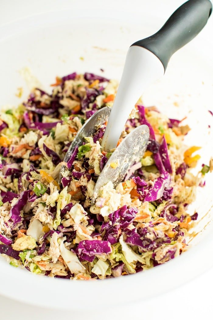 Asian salad being chopped in an OXO salad chopper bowl.