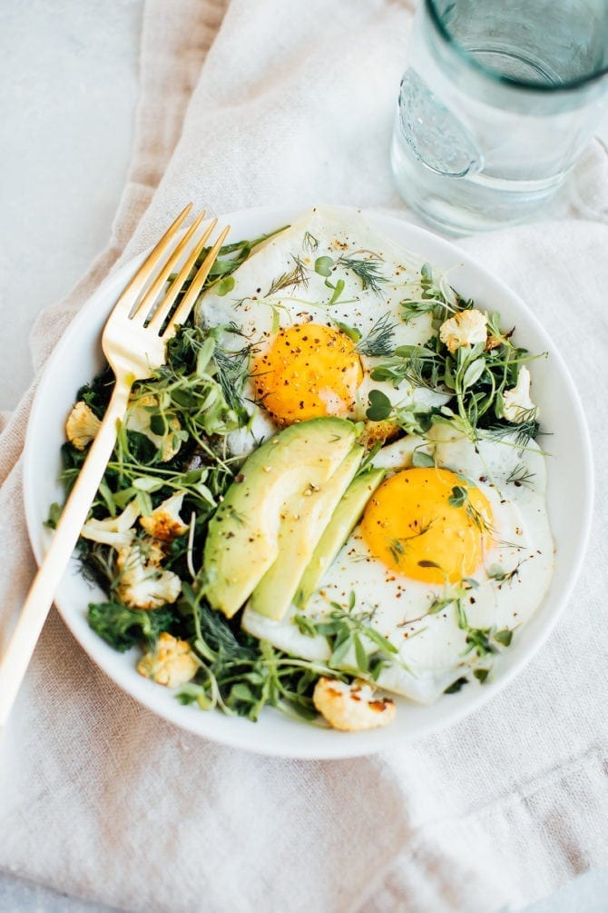 breakfast salad with veggies and eggs on top