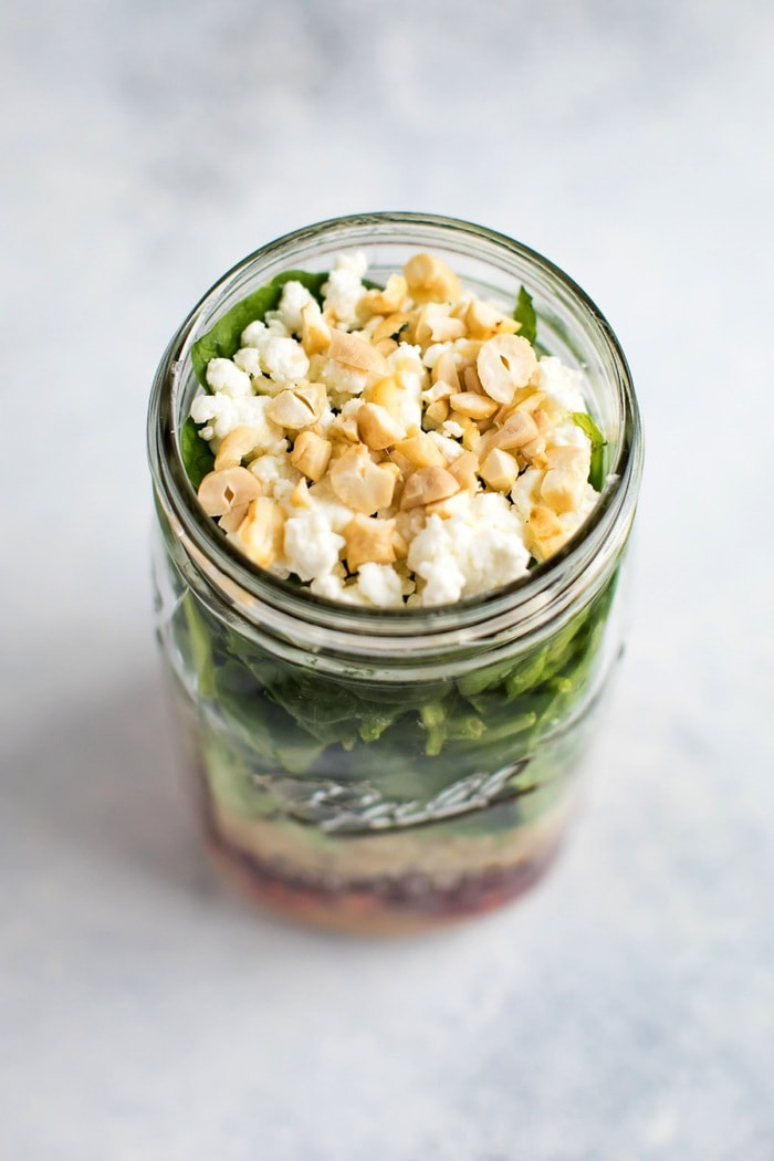 Beet salad in a mason jar, top view with goat cheese and cashews on top.