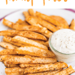 """A white plate of turnip fries and a jar of ranch dip on top of a purple napkin. Text """"Baked Turnip Fries"""" is written at the top of the image."""