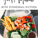"""Salad with lobster, tomatoes, cucumbers, dressing, and fries in a plastic container. Text reads """"A Visit to York, Maine with Stonewall Kitchen"""""""