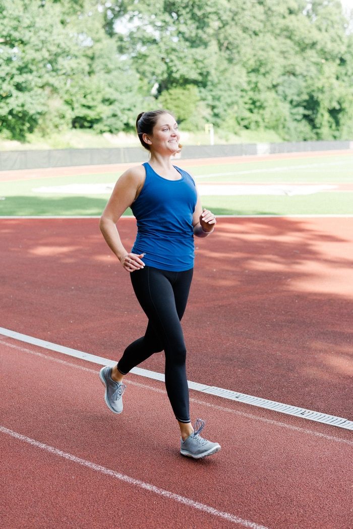 Women running on track wearing Athleta Run Free workout gear.