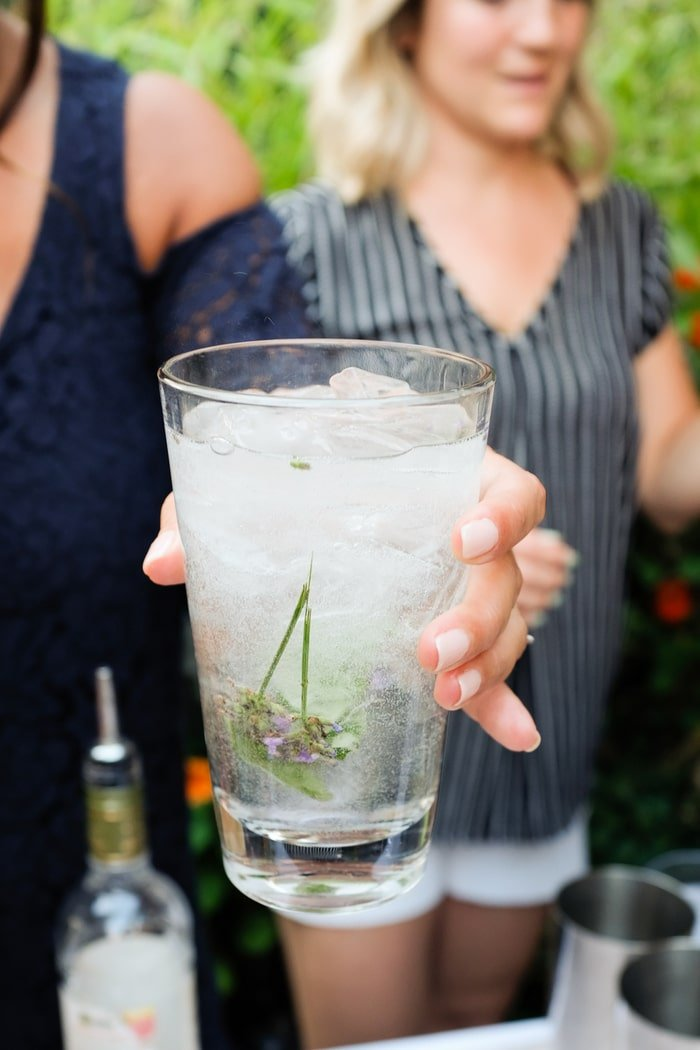 Woman holding a Vodka Soda with Ketel One Botanicals
