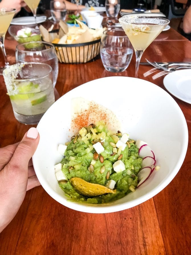 bowl of guacamole at a restaurant table