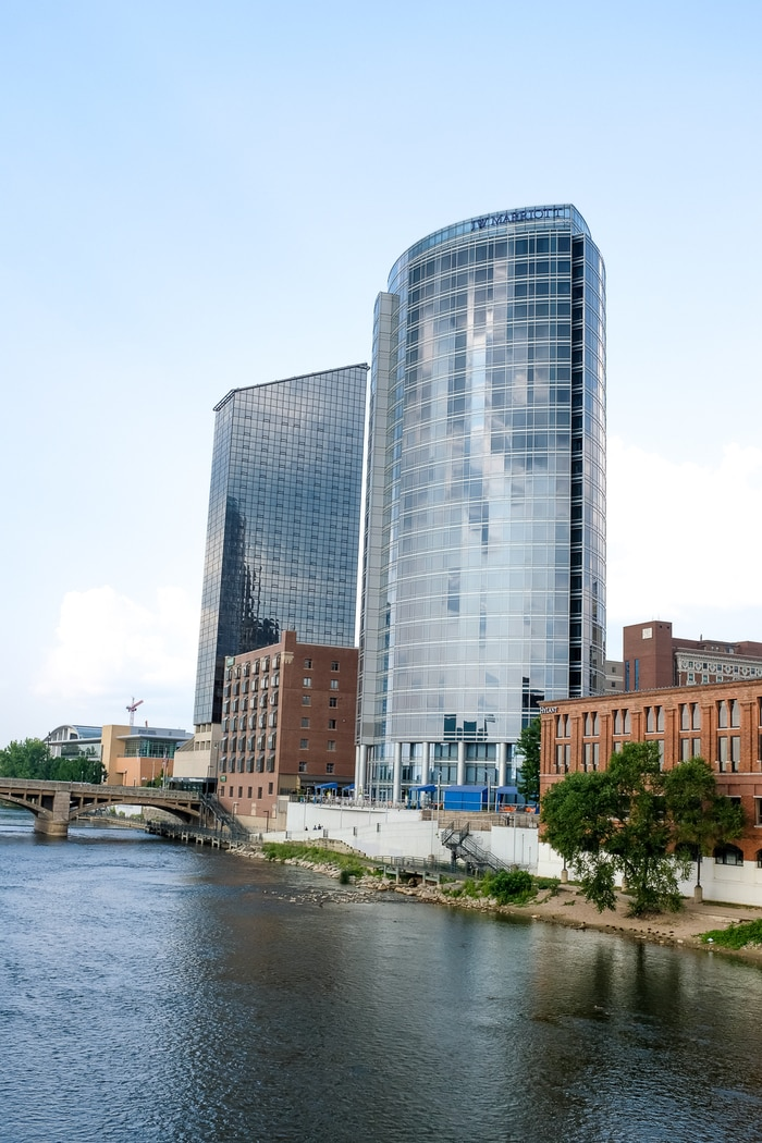 JW Marriott Hotel Grand Rapids Downtown, a tall skyscraper-like building on the river.