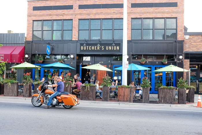 Butcher's Union, a restaurant with an outdoor patio along a city street in Grand Rapids, MI.