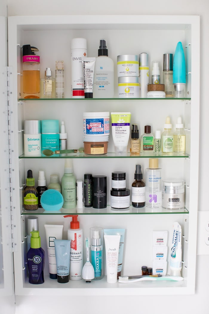 Organized medicine cabinet with skin, hair and beauty items.