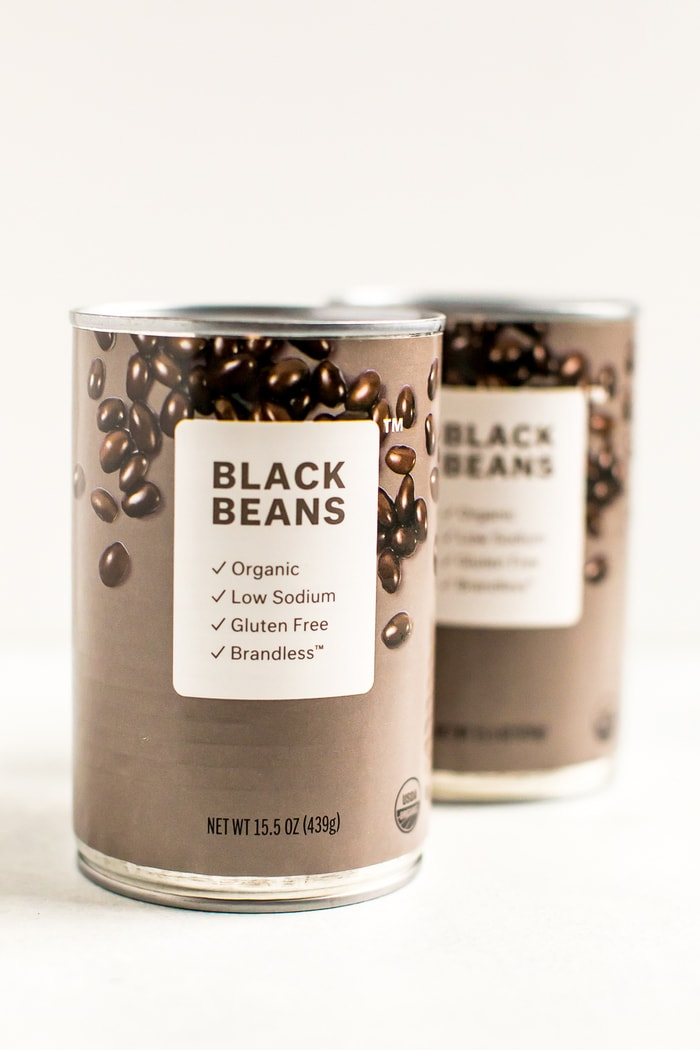 Two cans of Brandless black beans.