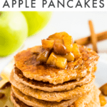 Stack of healthy apple pancakes topped with cinnamon apples. Behind the plate are some Granny Smith apples and cinnamon sticks. Text above reads Healthy Apple Pancakes.