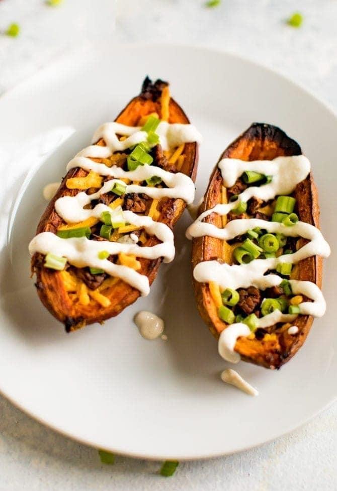Vegan sweet potato skins with tempeh bacon, vegan cheddar and sour cream.