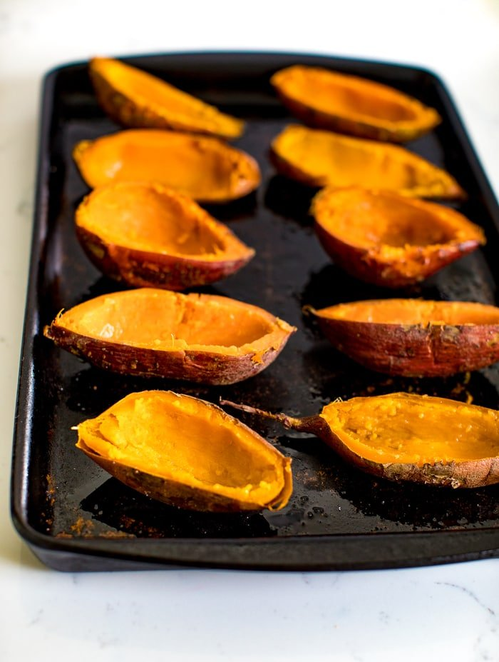 Baked sweet potato skins on a baking stone ready for filling.