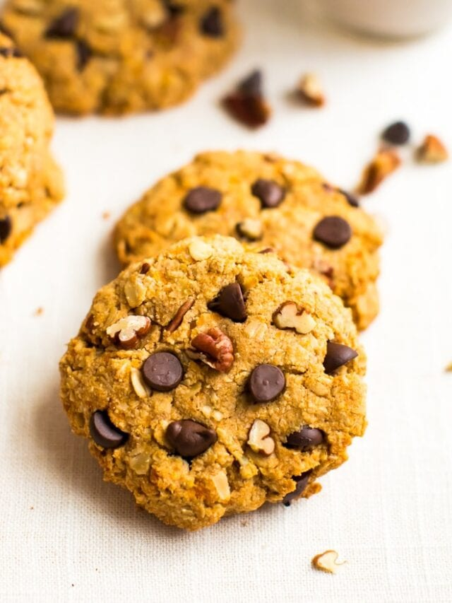 Healthy sweet potato breakfast cookies on a table, make with oats, pecans, and chocolate chips.