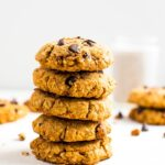 A stack of healthy sweet potato breakfast cookies made with oats, chocolate chips, and pecans.