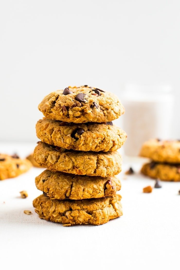 A stack of healthy sweet potato breakfast cookies make with oats, chocolate chips, and pecans.