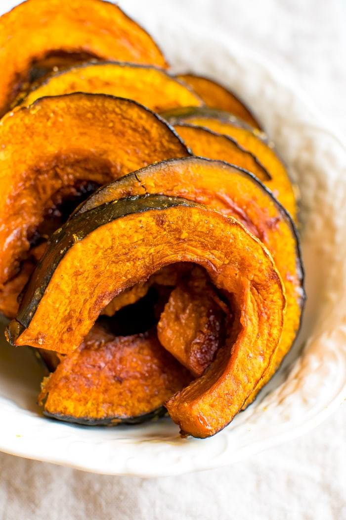 Maple roasted kabocha squash in a white bowl.