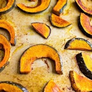 Maple roasted kabocha squash on a baking sheet.