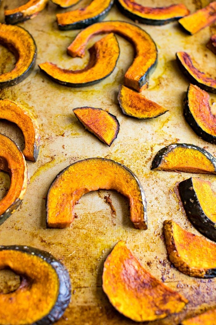 Maple roasted kabocha squash on a baking sheet.