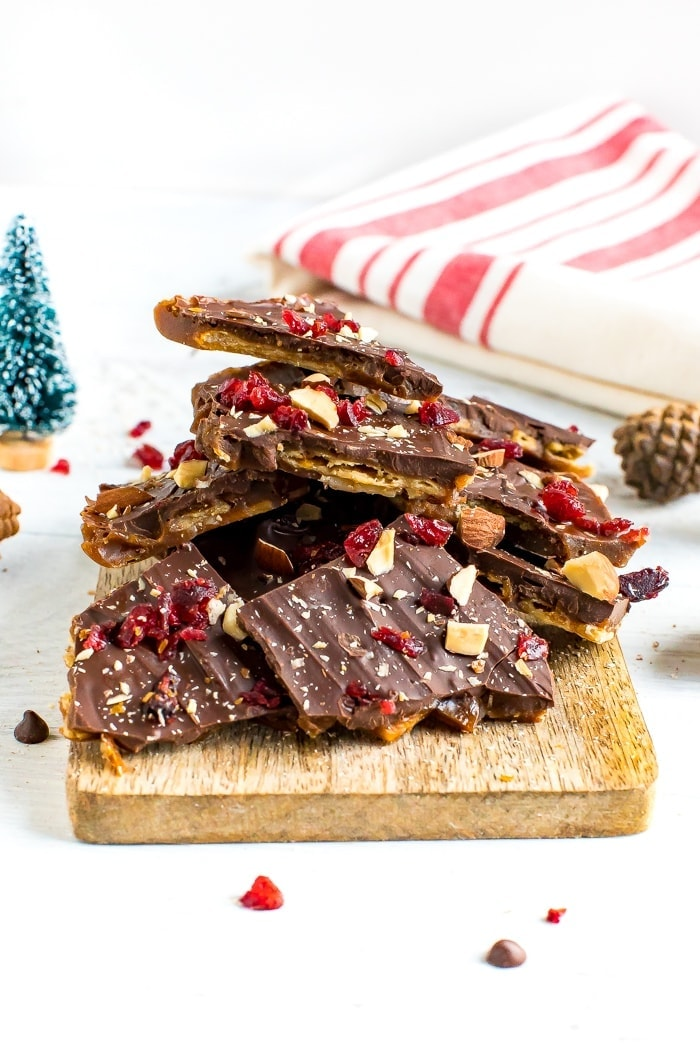 Healthy Christmas Crack made with toffee, almond crackers and topped with chocolate, nuts and cranberries.