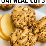 Three apple cinnamon baked oatmeal cups on a plate and drizzled with peanut butter.