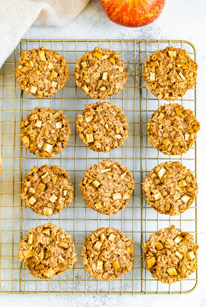 Apple cinnamon oatmeal cups on a gold cooling rack.